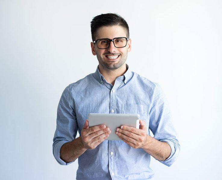 Portrait of cheerful excited tablet user wearing eyeglasses