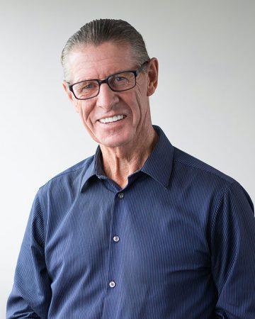 Happy Senior Man Wearing Glasses Smiling at Camera