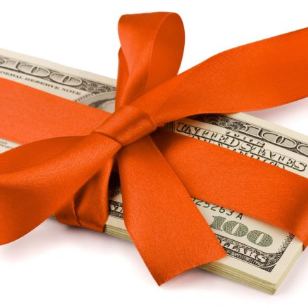 Home Thumbnail WholesomeGives money wrapped up in ORANGE ribbon