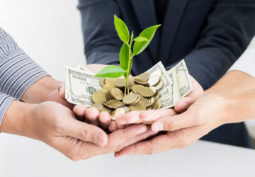 Blog One Detail Page NEW 2nd Replacement Image – hands holding growing money Suggested Crop