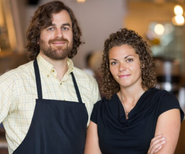 For Restaurant Partners on Home Page – Two person RP team close up Suggested Crop